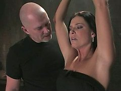 Suspension and forced orgasms for brunette