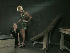 Black tranny Mistress spanks and dominates latex-clad slaveboy
