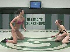 Aggressive submission wrestling between two naked women