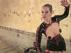 Latex-clad Mistress flogs her slaveboy