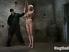 Busty blonde bound in rope and forced to suck cock