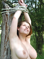 Lustful girl tied down in all directions the countryside
