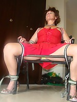 red dressed housewife tied to chair