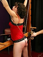 Cutie endures tit torture, ass hook and a caning