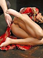 Kimono-clad brunette struggles in classic Shibari bondage