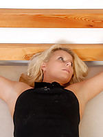 Blonde bound to futon and teased