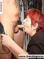 Slaveboy bound and teased by redheaded MILF