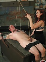 Redheaded teacher delivers vicious caning to naughty male student