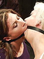 Cherry is zip-tied over the dome while Ariel X is electrified inside. Heavy whippings, jolting shocks, sweaty bodies, two girls at the same time.