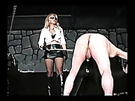 Cruel mistress beating by stick o slave ass