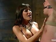 Gorgeous dominatrix locks slaveboy up
