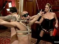 Hot dominatrix uses two slaves