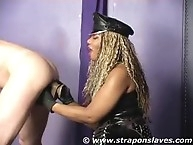 Dominant bitch inserted a huge dildo into slave`s asshole