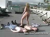 Naked big boob tramples on men