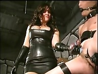 Bondage bitch on chair is getting spank to his ball
