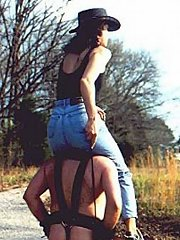 Riding mistress is on man