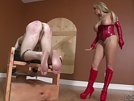 Blonde dominatrix in red latex spanked bad boy