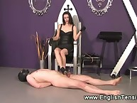 The dominatrix got her stockinged legs licked