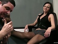 A slave was humiliated under black shoes