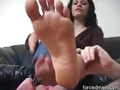 Slave is used as a feet cleaner by mistress