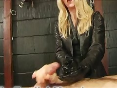 Dominatrix in gloves was jerking off man's dick