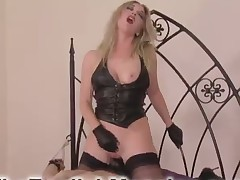 A poor tied sub is smothered by blond domme