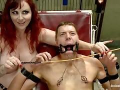 Dominatrix with big butt and tits smothers her slaveboy