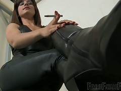 Dominatrix in leather teased her slave