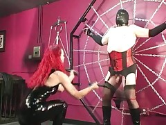 Redhead feral Domina punitive together with unbearable pushed bottom less corset together with stockings