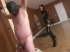 Latex brunette was spanking her roped malesub hard
