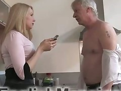Slave is under feet of sexy blond Dominatrix