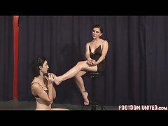 Dominatrix is very glad that she has such foot slave