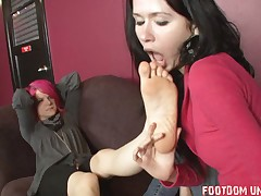 This slave is used to clean boots of his Dominatrix