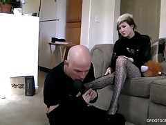 Sexy brunet hoe in black stockings with her foot slave