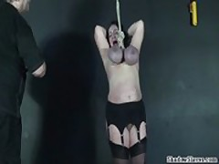 Tit hanging torture of mature roped slavegirl Andrea in extreme big tit whipping