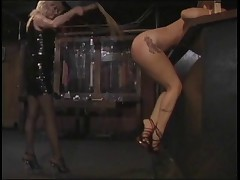 Submissive girl bent over taking a spanking to her ass