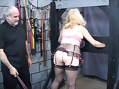 Busty, mature blonde gets her ass whipped in the dungeon