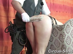 SM-Circus: newspaper spanking for Yvette Costeau