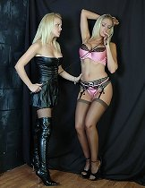 A horny FemDom in leather punishes a naughty little slut