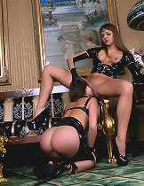 Louisa & Nika in strap-on dildo lesbian dom sub sex action