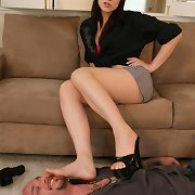 A boy eats mistress` feet
