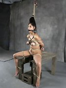 She is tied into a human knot and has multiple orgasms