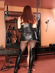 Mistress Ramirez plys with her slave in Leather and Bondage