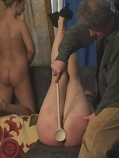 <!–-IMAGE_COUNT-–> of Diaper Spanking with Wooden Spoon