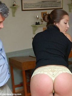 <!–-IMAGE_COUNT-–> of Leather paddle on her bare bottom