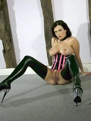 Slave wore in latex corset and boots