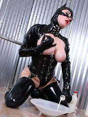 Latex Kittie Gets Messy With Milk