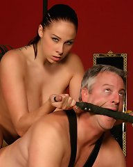 Young mistress riding mature male\'s back