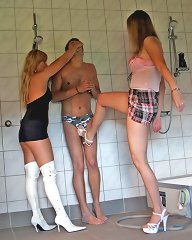 Two dominatrixes trampled malesub hard in the bath-room