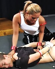 Maxine X captures a would-be burglar and ties her up in the basement in this bondage scene